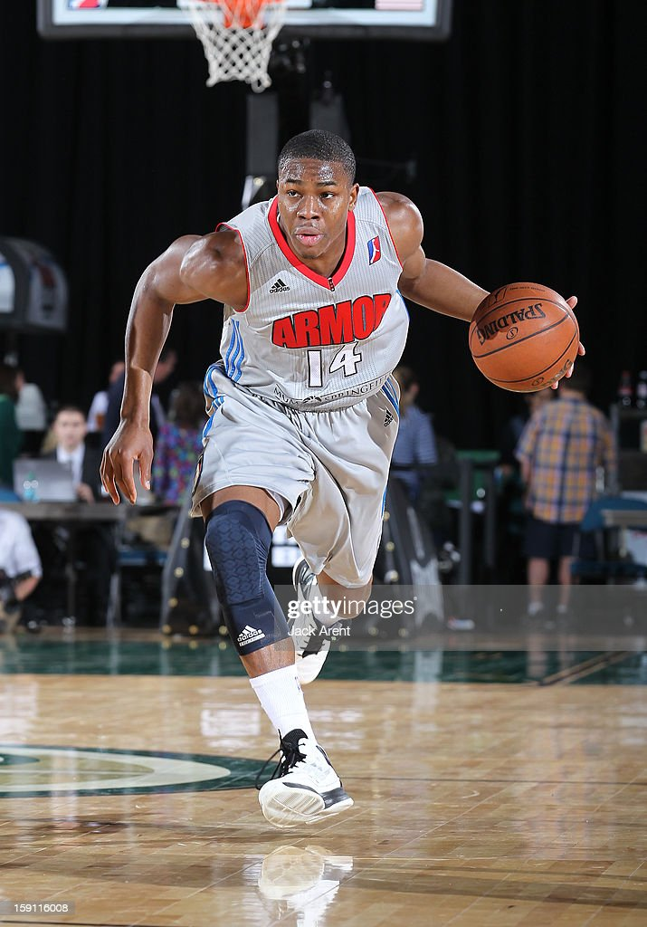 Ben Uzoh #14 of the Springfield Armor dribbles the ball against the Reno Bighorns during the 2013 NBA D-League Showcase on January 7, 2013 at the Reno Events Center in Reno, Nevada.