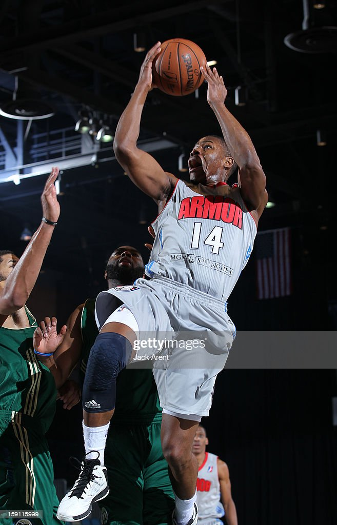 Ben Uzoh #14 of the Springfield Armor shoots the ball against the Reno Bighorns during the 2013 NBA D-League Showcase on January 7, 2013 at the Reno Events Center in Reno, Nevada.