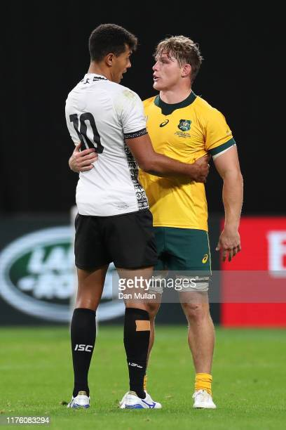 Ben Volavola of Fiji embraces Michael Hooper of Australia following the Rugby World Cup 2019 Group D game between Australia and Fiji at Sapporo Dome...
