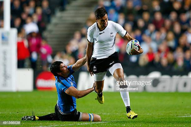 Ben Volavola of Fiji evades Jorge Zerbino of Uruguay during the 2015 Rugby World Cup Pool A match between Fiji and Uruguay at Stadium mk on October 6...