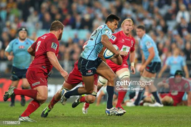 Ben Volavola of the Waratahs runs the ball during the round 20 Super Rugby match between the Waratahs and the Reds at ANZ Stadium on July 13 2013 in...