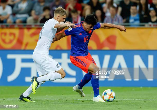 Ben Waine of New Zealand and Brayan Vera of Colombia battle for the ball during the 2019 FIFA U20 World Cup Round of 16 match between Colombia and...