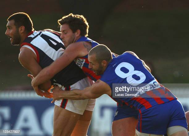Ben Waite of the Scorpions is tackled during the VFL quarter final match between Port Melbourne and Casey Scorpions at TEAC Oval on September 3, 2011...