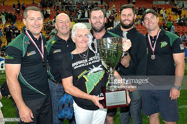 Ben Walker Chris Walker and Shane Walker pose for a photo with father Gary Walker and mother Trish Walker after the Queensland Cup Rugby League Grand...