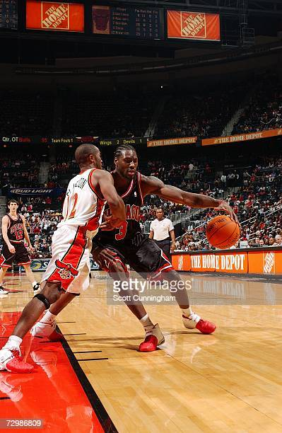 Ben Wallace of the Chicago Bulls drives against Speedy Claxton of the Atlanta Hawks at Philips Arena on December 16 2006 in Atlanta Georgia The Bulls...