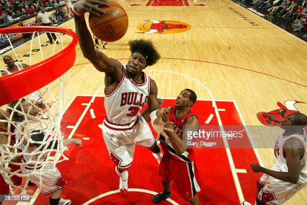 Ben Wallace of the Chicago Bulls pulls down a rebound against LaMarcus Aldridge of the Portland Trail Blazers at the United Center January 3 2008 in...