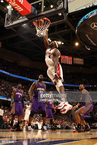 Ben Wallace of the Cleveland Cavaliers dunks the ball surrounded by Amare Stoudemire Shaquille O'Neal Matt Barnes and Leandro Barbosa of the Phoenix...