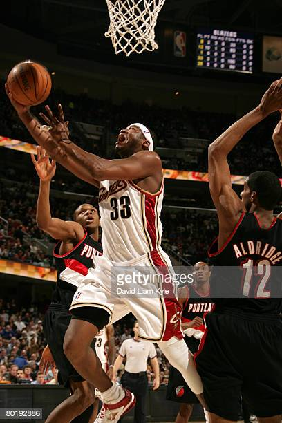 Ben Wallace of the Cleveland Cavaliers puts up the shot defended by LaMarcus Aldridge of the Portland Trail Blazers on March 10 2008 at The Quicken...