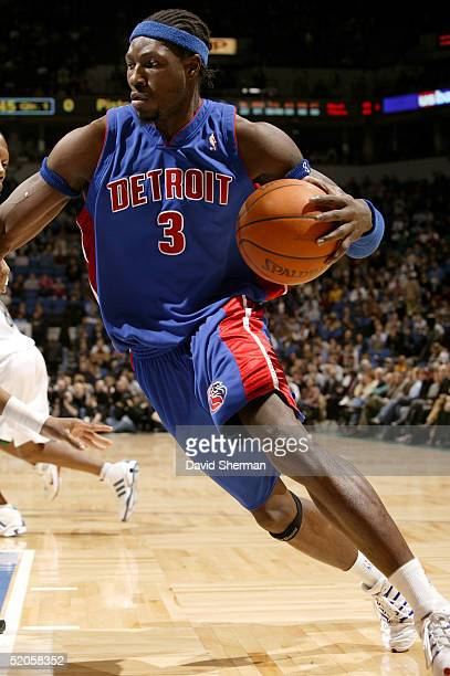 Ben Wallace of the Detroit Pistons drives to the basket against Ervin Johnson of the Minnesota Timberwolves on January 24 2005 at the Target Center...