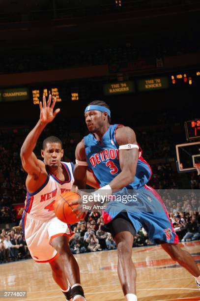 Ben Wallace of the Detroit Pistons drives to the basket against Kurt Thomas of the New York Knicks on December 1 2003 at Madison Square Garden in New...