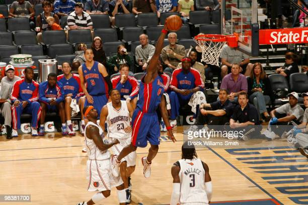 Ben Wallace of the Detroit Pistons dunks against Gerald Wallace of the Charlotte Bobcats on April 10 2010 at the Time Warner Cable Arena in Charlotte...