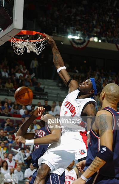 Ben Wallace of the Detroit Pistons dunks over Jason Collins of the New Jersey Nets in Game one of the Eastern Conference Finals during the 2003 NBA...