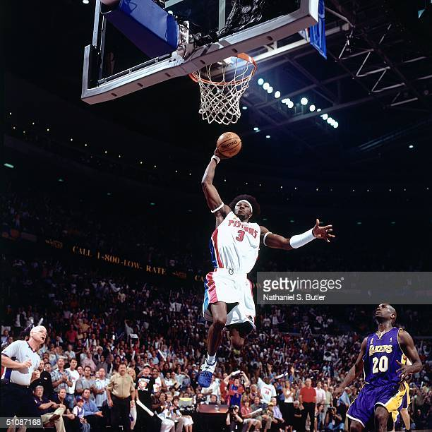 Ben Wallace of the Detroit Pistons dunks past Gary Payton of the Los Angeles Lakers during Game Five of the 2004 NBA Finals on June 15, 2004 at The...