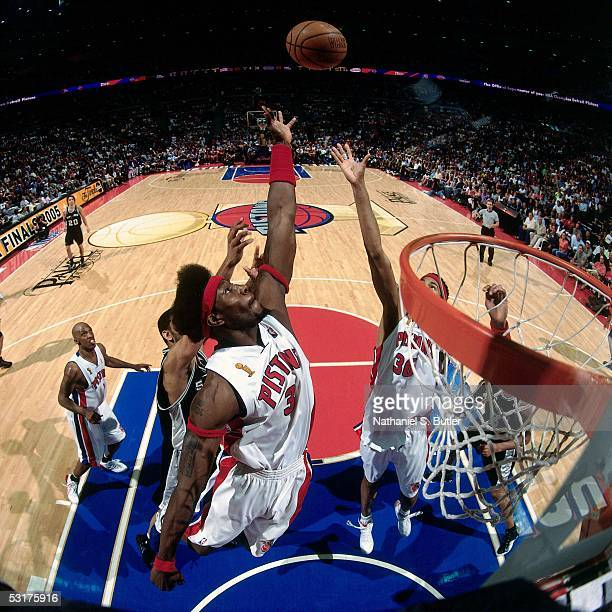 Ben Wallace of the Detroit Pistons goes for a rebound against Tim Duncan of the San Antonio Spurs in Game Five of the 2005 NBA Finals at the Palace...