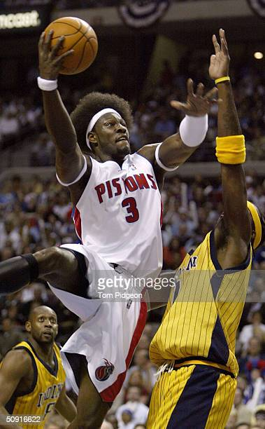 Ben Wallace of the Detroit Pistons goes to the basket over Jermaine O'Neal of the Indiana Pacers in Game six of the Eastern Conference Finals during...