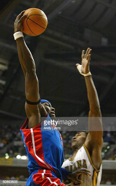 Ben Wallace of the Detroit Pistons goes up for a basket over Ron Artest of the Indiana Pacers in Game two of the Eastern Conference Finals during the...