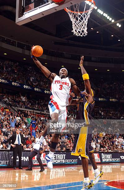 Ben Wallace of the Detroit Pistons goes up for a dunk attempt over Jermaine O'Neal of the Indiana Pacers October 29 2003 at the Palace of Auburn...