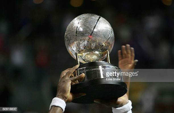 Ben Wallace of the Detroit Pistons holds up the Eastern Conference championship trophy after defeating the Indiana Pacers in Game six of the Eastern...