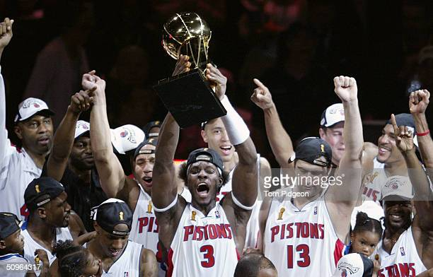 Ben Wallace of the Detroit Pistons holds up the Larry O'Brien NBA Championship trophy as he celebrates with teammatesafter defeating the Los Angeles...