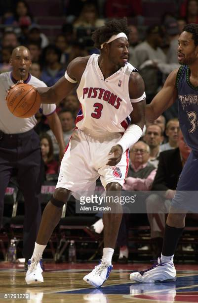 Ben Wallace of the Detroit Pistons is defended by Michael Olowokandi of the Minnesota Timberwolves during the game at The Palace of Auburn Hills on...