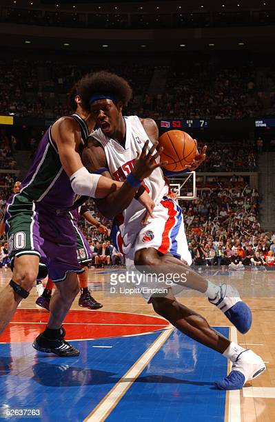 Ben Wallace of the Detroit Pistons is fouled by Dan Gadzuric of the Milwaukee Bucks April 15 2005 at the Palace of Auburn Hills in Auburn Hills...