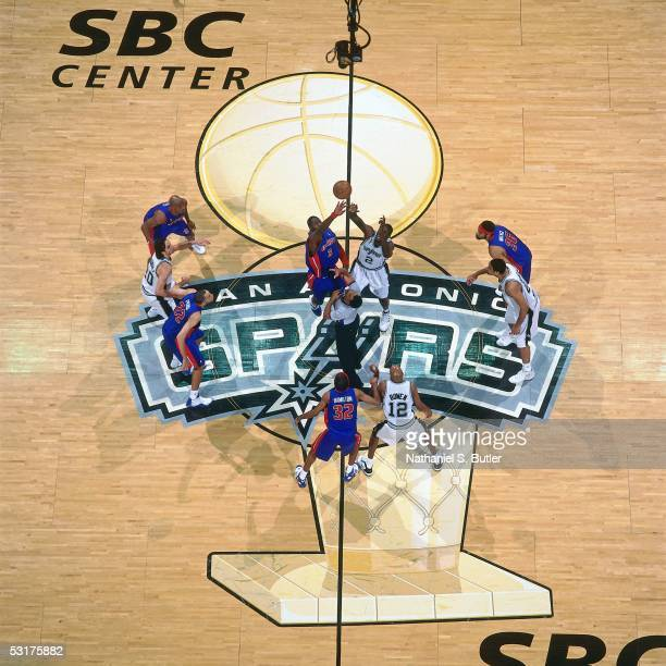 Ben Wallace of the Detroit Pistons jumps against Nazr Mohammed of the San Antonio Spurs in Game Six of the 2005 NBA Finals June 21 2005 at the SBC...