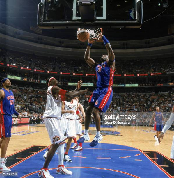 Ben Wallace of the Detroit Pistons makes a dunk against Samuel Dalembert of the Philadelphia 76ers during game three round one of the Eastern...