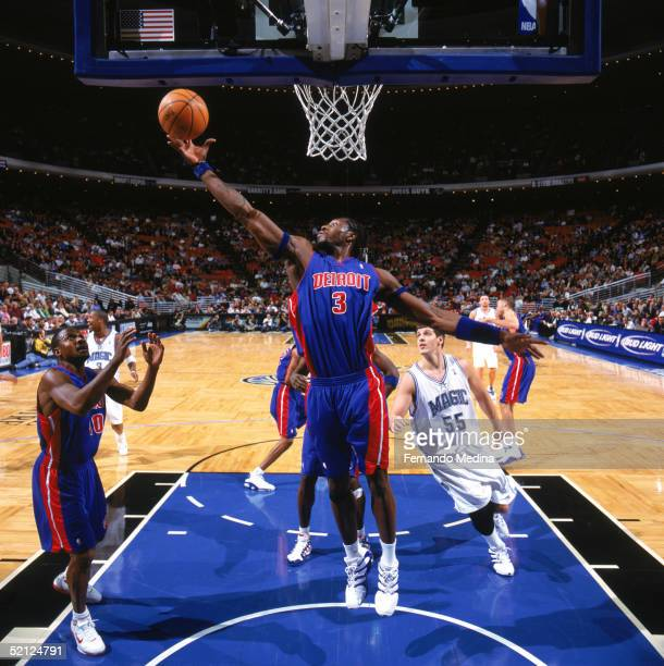 Ben Wallace of the Detroit Pistons reaches for a rebound during a game against the Orlando Magic at TD Waterhouse Centre on January 18, 2005 in...