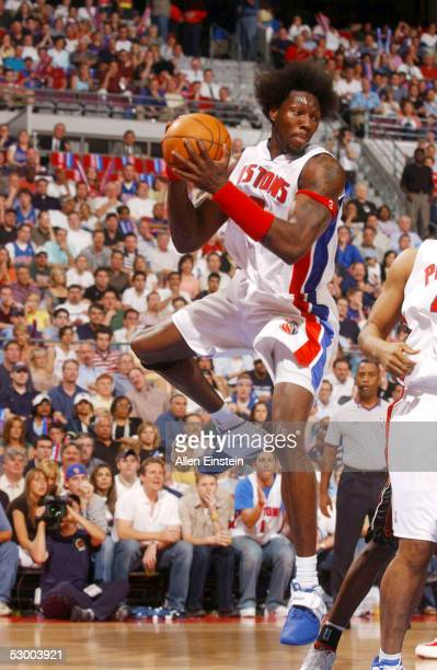 Ben Wallace of the Detroit Pistons rebounds against the Miami Heat in Game four of the Eastern Conference Finals during the 2005 NBA Playoffs on May...