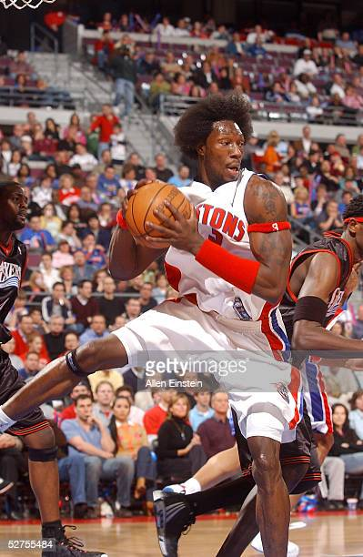 Ben Wallace of the Detroit Pistons rebounds against the Philadelphia 76ers in Game five of the Eastern Conference Quarterfinals during the 2005 NBA...