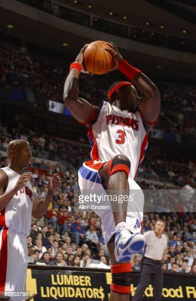 Ben Wallace of the Detroit Pistons rebounds in front of teammate Chauncey Billups during their game against the Dallas Mavericks at the Palace of...