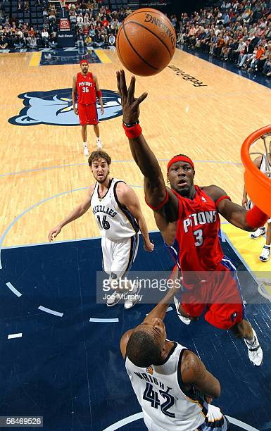 Ben Wallace of the Detroit Pistons shoots a layup over Lorenzen Wright of the Memphis Grizzlies during a game between the Detroit Pistons and Memphis...