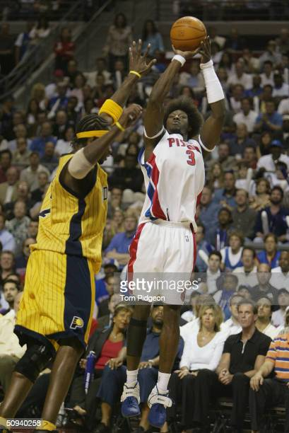 Ben Wallace of the Detroit Pistons shoots over Jermaine O'Neal of the Indiana Pacers in Game six of the Eastern Conference Finals during the 2004 NBA...