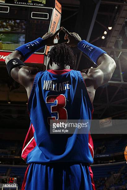 Ben Wallace of the Detroit Pistons signals the play during the NBA game against the Cleveland Cavaliers at Gund Arena on February 16 2003 in...