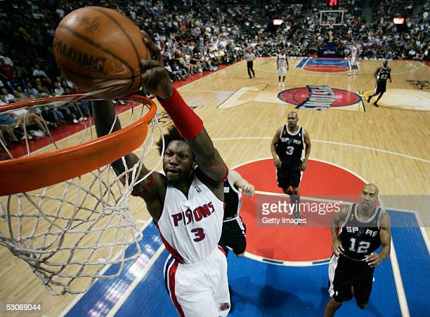 Ben Wallace of the Detroit Pistons slam dunks the basketball against the San Antonio Spurs defense in the fourth quarter of Game three of the 2005...