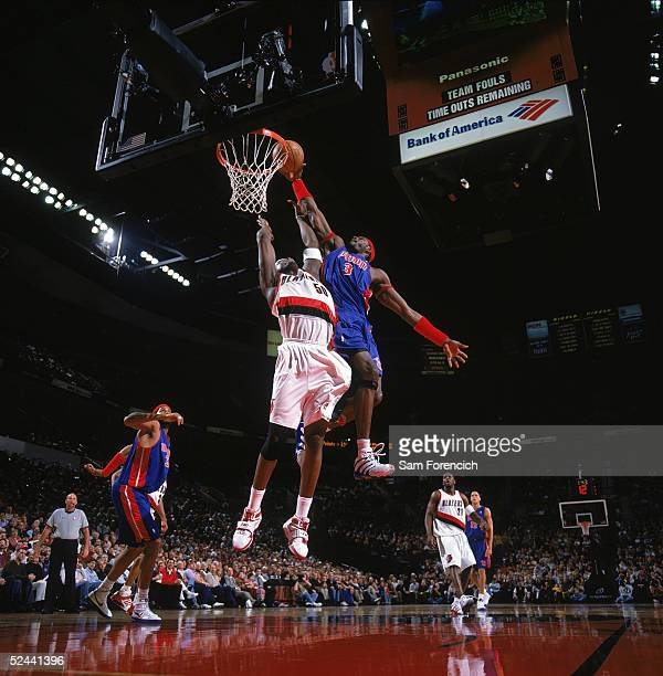 Ben Wallace of the Detroit Pistons takes the ball to the basket over Zach Randolph of the Portland Trail Blazers during the game at The Rose Garden...