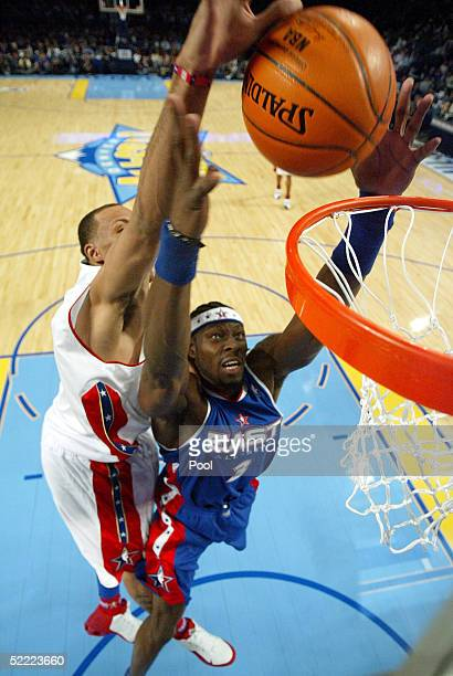 Ben Wallace of the Eastern Conference AllStars and Shawn Marion of the Western Conference AllStars go after a rebound during the 54th AllStar Game...