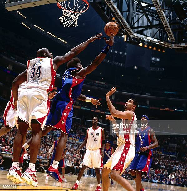 Ben Wallace of the Eastern Conference AllStars shoots against Shaquille O'Neal of the Western Conference AllStars during the 2004 AllStar Game on...