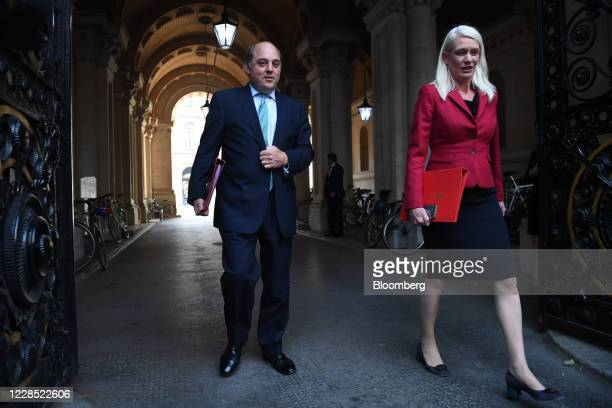 Ben Wallace, U.K. Defence secretary, left, and Amanda Milling, chairman of the Conservative Party, depart from a meeting of cabinet ministers in...