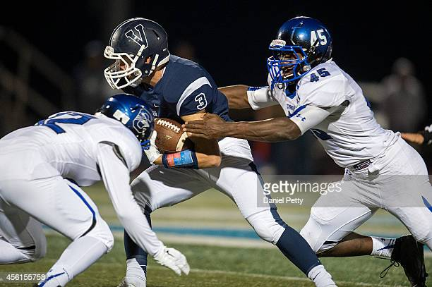 Ben Waters of Valor Christian tries to break tackles of Kalif Roberts of Chandler at Valor Stadium on September 12 in Highlands Ranch, Colorado....