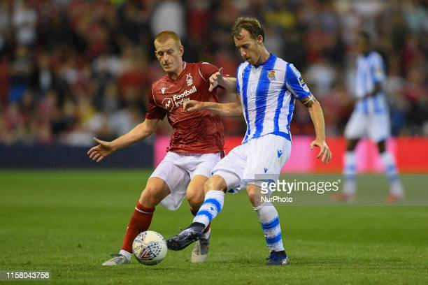 Ben Watson of Nottingham Forest battles with David ZURUTUZA of Real Sociedad during the Pre-season Friendly match between Nottingham Forest and Real...