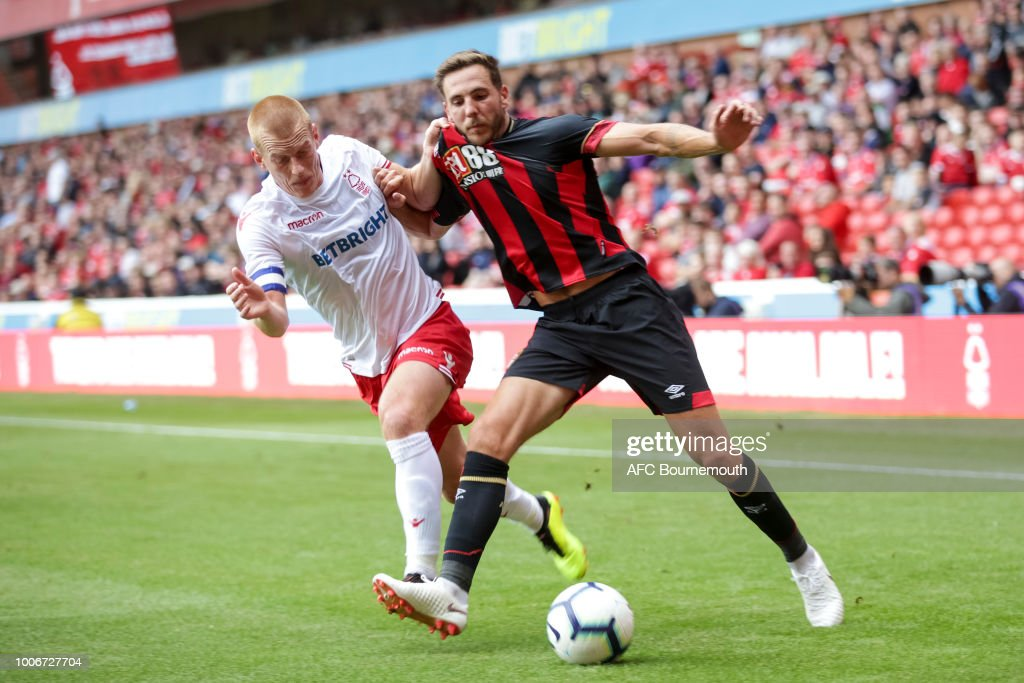 Ben Watson of Nottingham Forest holds off Dan Gosling of Bournemouth during pre-season friendly between between Nottingham Forest and AFC Bournemouth at City Ground on July 28, 2018 in Nottingham, England.