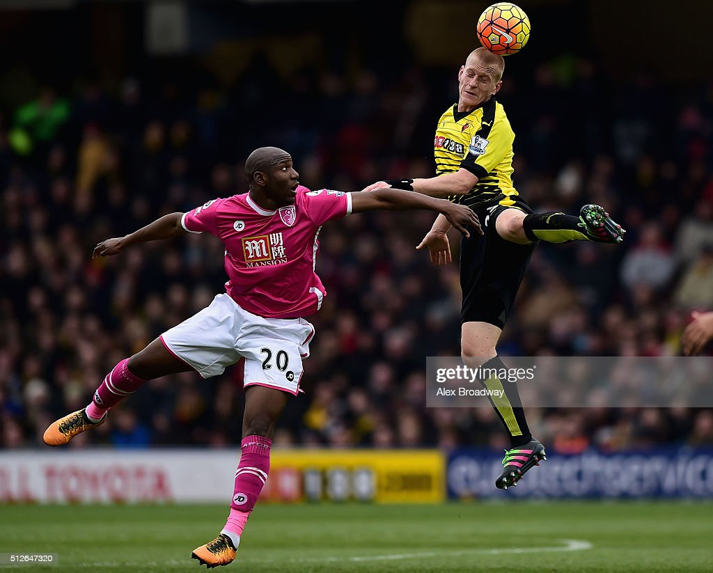 Ben Watson of Watford and Benik Afobe of Bournemouth compete for the ball during the Barclays Premier League match between Watford and A.F.C. Bournemouth at Vicarage Road on February 27, 2016 in Watford, England.