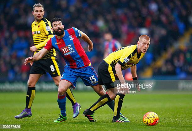 Ben Watson of Watford and Mile Jedinak of Crystal Palace compete for the ball during the Barclays Premier League match between Crystal Palace and...