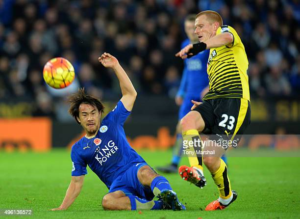 Ben Watson of Watford and Shinji Okazaki of Leicester City compete for the ball during the Barclays Premier League match between Leicester City and...