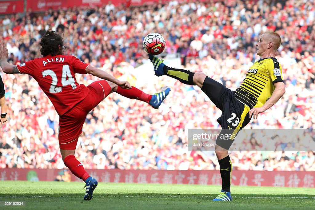 Ben Watson of Watford battles for the ball with Joe Allen of Liverpool during the Barclays Premier League match between Liverpool and Watford at Anfield on May 8, 2016 in Liverpool, England.