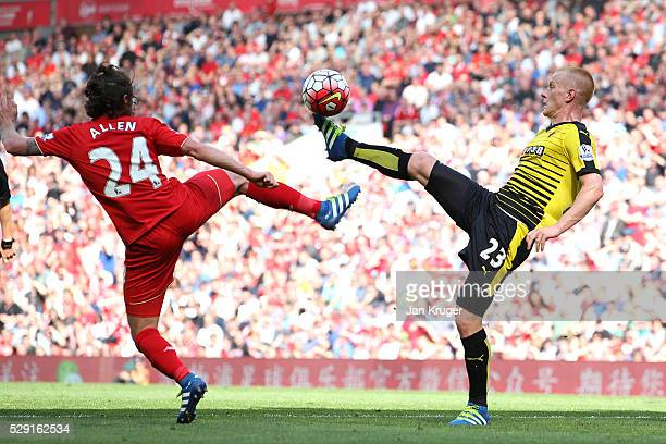 Ben Watson of Watford battles for the ball with Joe Allen of Liverpool during the Barclays Premier League match between Liverpool and Watford at...