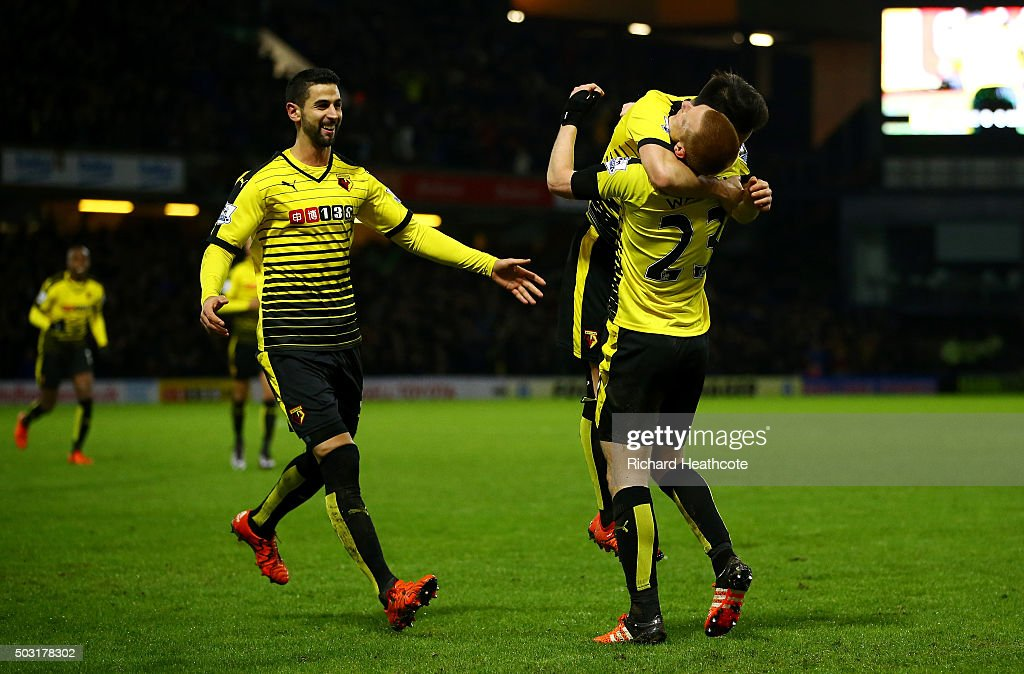 Ben Watson of Watford (r) celebrates with his team mates after scoring his side's first goal from a corner during the Barclays Premier League match between Watford and Manchester City at Vicarage Road on January 2, 2016 in Watford, England.