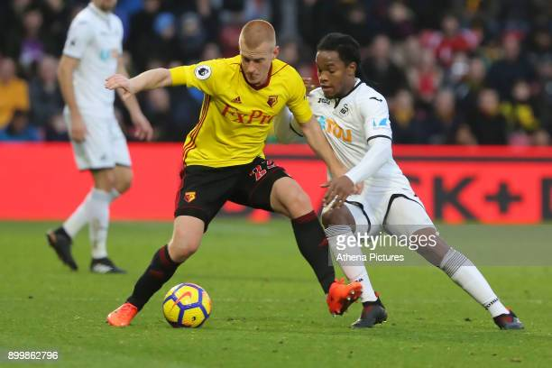Ben Watson of Watford challenged by Renato Sanches of Swansea City during the Premier League match between Watford and Swansea City at the Vicarage...