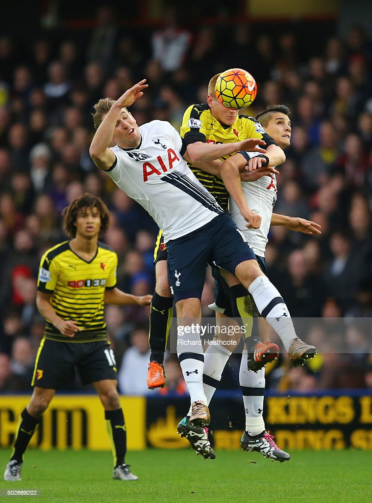 Ben Watson (C) of Watford competes for the ball against Harry Kane (L) and Erik Lamela (R) of Tottenham Hotspur during the Barclays Premier League match between Watford and Tottenham Hotspur at Vicarage Road on December 28, 2015 in Watford, England.